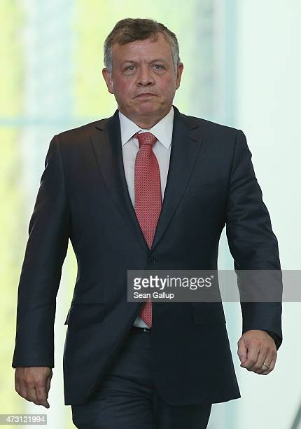 King Abdullah II of Jordan arrives to speak to the media with German Chancellor Angela Merkel following talks at the Chancellery on May 13 2015 in...