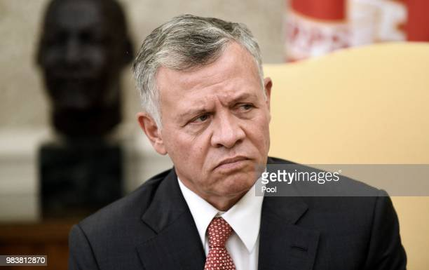 King Abdullah II of Jordan attends a meeting with President Donald Trump in the Oval Office of the White House on June 25 2018 in Washington DC