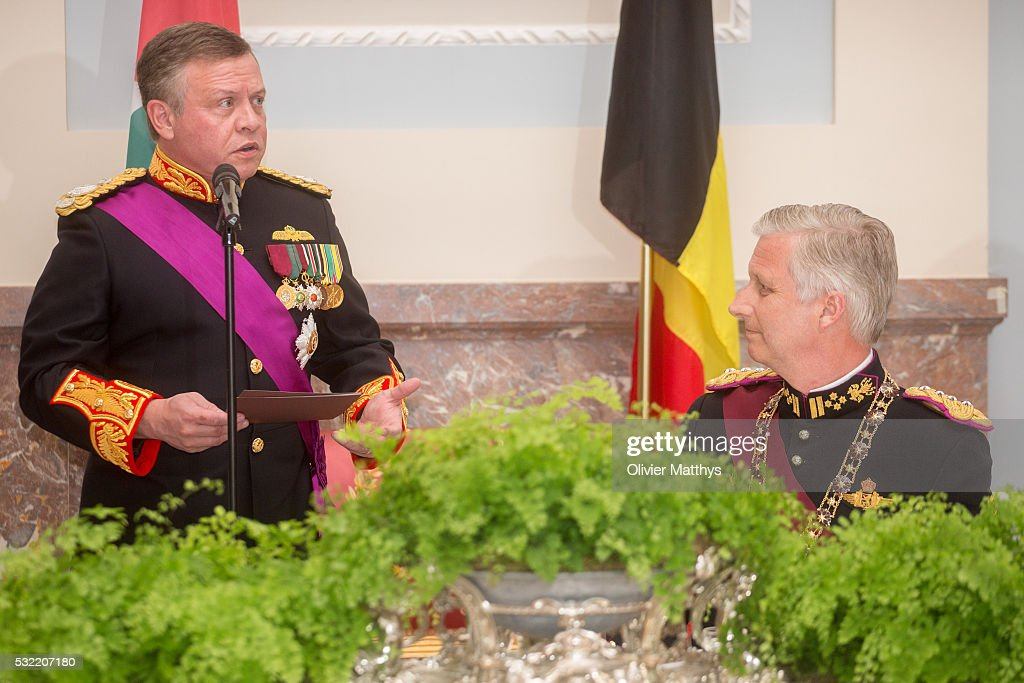 King Abdullah II of Jordan delivers a speech as King Philippe of Belgium looks on during the gala dinner at the Royal Palace of Lakaen on May 18, 2016 in Brussels, Belgium.