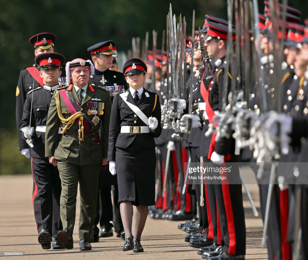 King Abdullah II of Jordan inspects the Officer Cadets as he represents Queen Elizabeth II during the Sovereign's Parade at the Royal Military Academy Sandhurst on August 11, 2017 in Camberley, England. The Sovereign's Parade takes place in the Old College Square at Sandhurst's Royal Military Academy at the end of each term and marks the passing out of Officer Cadets who have completed the commissioning course. King Abdullah graduated from the Royal Military Academy in 1981 and today his son Crown Prince Hussein of Jordan was one of the graduating Officer Cadets.