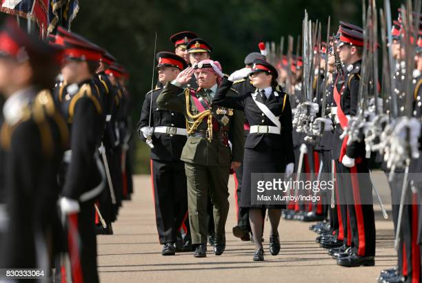 King Abdullah II of Jordan inspects the Officer Cadets as he represents Queen Elizabeth II during the Sovereign's Parade at the Royal Military...