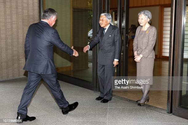 King Abdullah II of Jordan is welcomed by Emperor Akihito and Empress Michiko prior to their luncheon at the Imperial Palace on November 26 2018 in...