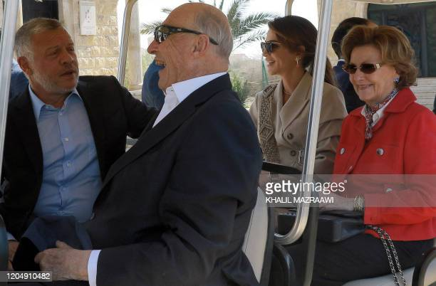 King Abdullah II of Jordan King Harald V of Norway Queen Rania of Jordan and Queen Sonja of Norway ride together in a golf cart at the baptism site...