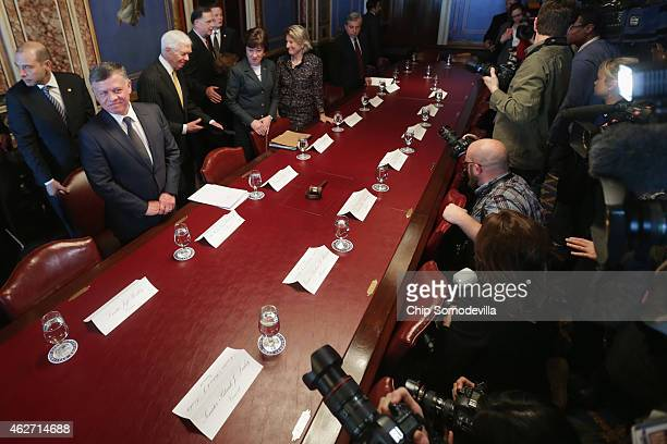 King Abdullah II of Jordan poses for photographs before meeting with members of the Senate Appropriations Committee at the U.S. Capitol February 3,...