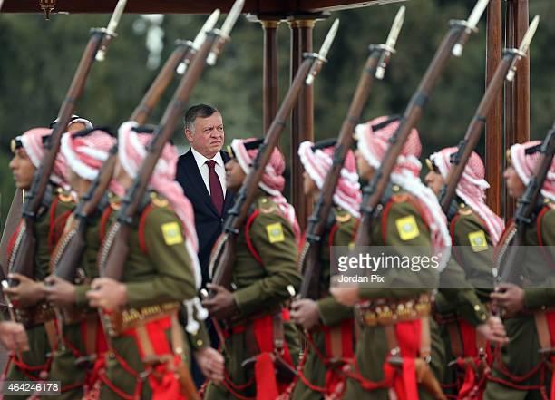 King Abdullah II of Jordan reviews the Bedouin honour guards as he welcomes Emir of Kuwait Sheikh Sabah AlAhmad AlJaber AlSabah to Amman for talks on...