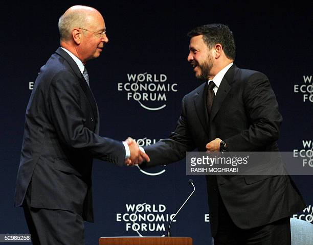 King Abdullah II of Jordan shakes hands with Professor Klaus Schwab of the World Economic Forum Switzerland at the final session of the WEF in the...