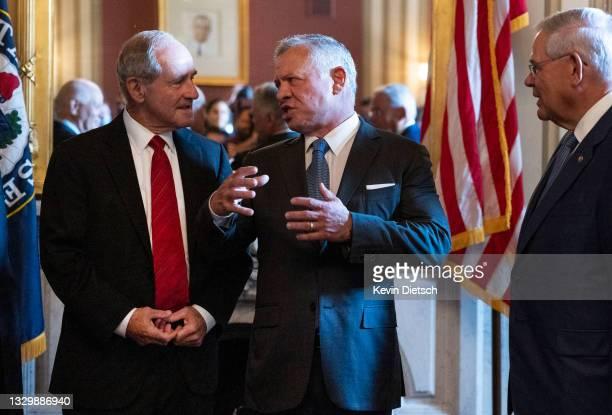 King Abdullah II Of Jordan talks to Sen. James Risch and Sen. Robert Menendez during a meeting at the U.S. Capitol on July 21, 2021 in Washington,...