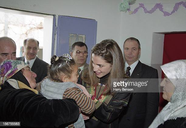 King Abdullah II of Jordan's wife Queen Rania is photographed greeting admirers for Life Magazine in 2000 in Ma'an, Jordan.