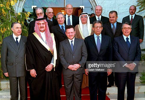 King Abdullah of Jordan center poses for an official picture with Arab foreign ministers February 11 2001 at a meeting in Amman From left to to right...