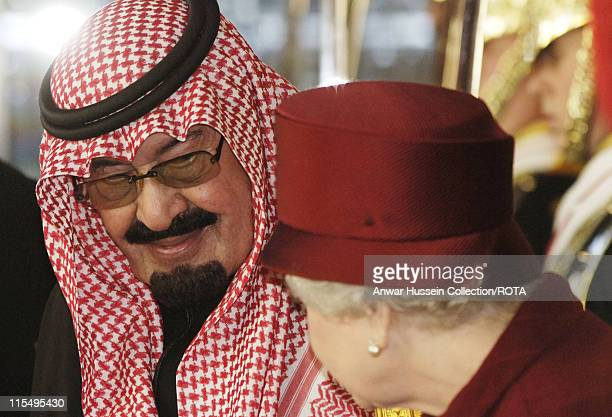 King Abdullah of Saudi Arabia and Queen Elizabeth ll arrive at Buckingham Palace following a ceremonial welcome on October 30 2007 in London England