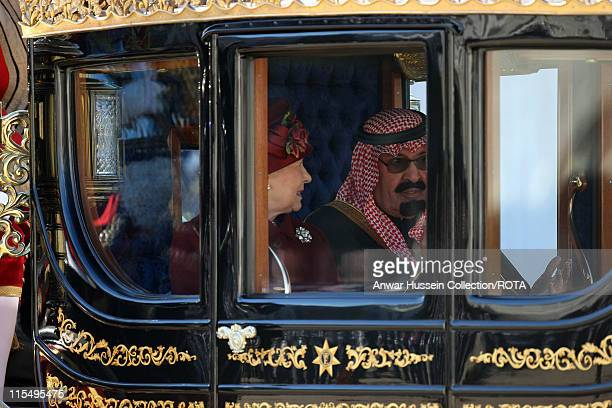 King Abdullah of Saudi Arabia and Queen Elizabeth ll travel in a State Carriage procession along the Mall on October 30 2007 in London England