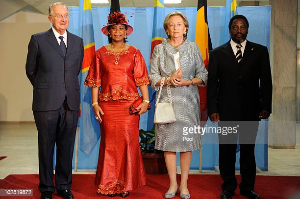 King Albert and Queen Paola of Belgium pose for a photo with and First Lady of Congo Olive Kabila and President of Congo Joseph Kabila at the Palais...
