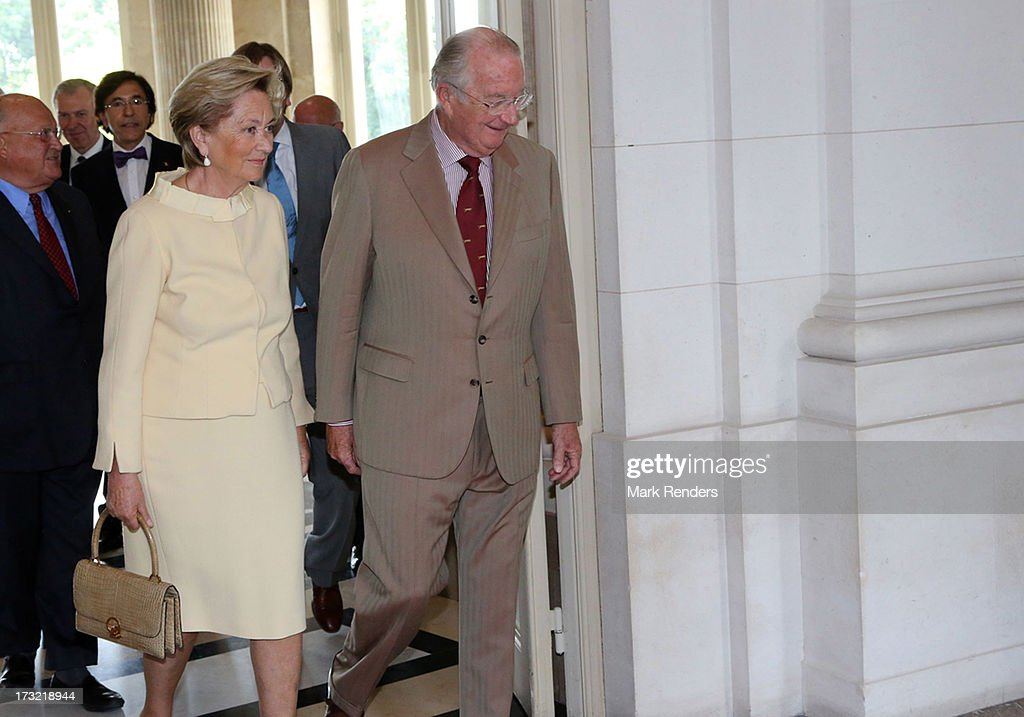 King Albert II (R) and Queen Paola of Belgium meet former Prime Ministers of Belgium at Laeken Castle on July 10, 2013 in Brussels, Belgium.
