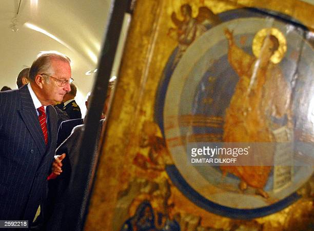King Albert II of Belgium looks at an exhibition of Orthodox icons in the goldendomed Alexander Nevski cathedral in central Sofia 15 October 2003 The...