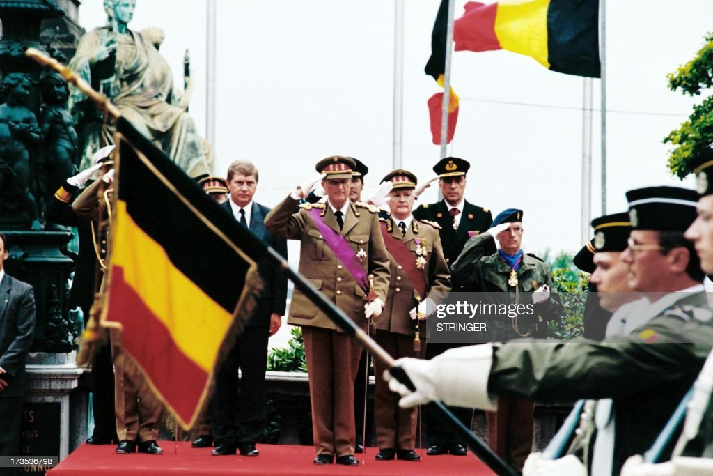 King Albert II of Belgium salutes the military parade, on August 9, 1993, during the constitutional oath of allegiance to the parliament, in Brussels.