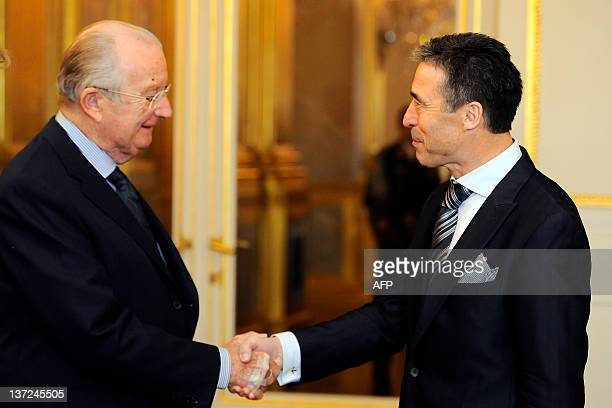 King Albert II of Belgium shakes hands with NATO's Secretary General Anders Fogh Rasmussen during a New Year's reception organized by the Royal...