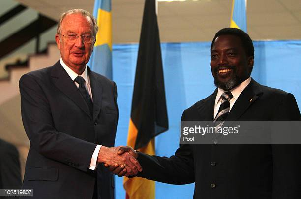 King Albert of Belgium and Congolese President Joseph Kabila shake hands at the Palais des Nations on 28 June 2010 in Kinshasa Congo King Albert and...