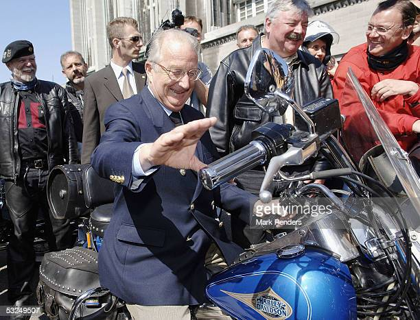 King Albert of Belgium sits on a Harley Davidson near the Heysel Stadion on July 17 2005 in Brussels Belgium