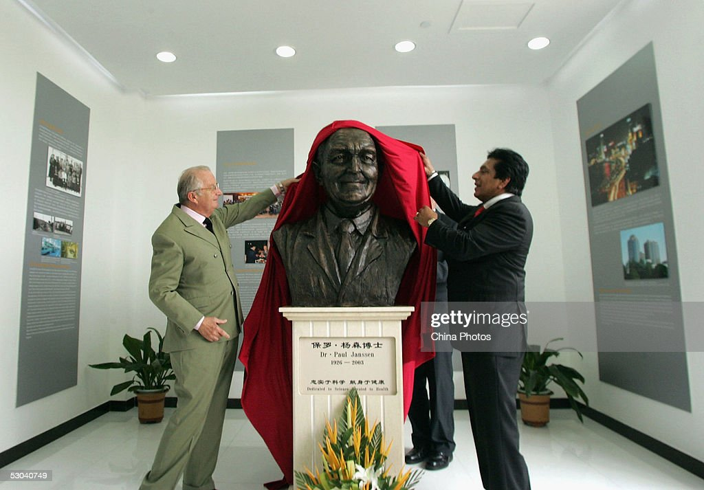 King Albert of Belgium (R) unveils a statue of Dr.Paul Janssen, the founder of Janssen Pharmaceuticals during his visit to Belgium's Janssen Pharmaceutica company on June 8, 2005 in Xian of Shaanxi Province, China. Belgium's King Albert and Queen Paola are on an eight-day state visit to China.