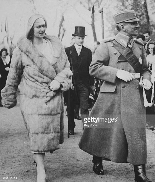 King Alexander I and Queen Marie of Yugoslavia attend the unveiling of a sculpture on Armistice Day in Belgrade, created as a tribute to France by...