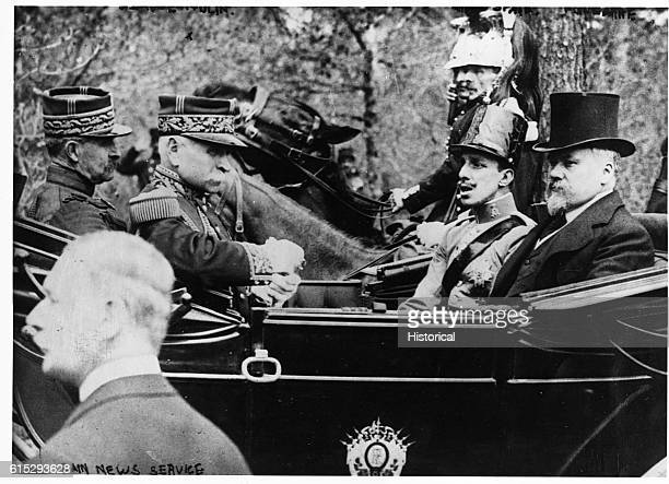 King Alfonse of Spain sits in a carriage with Raymond Poincare the Prime Minister of France | Location Madrid Spain
