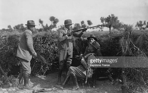 King Alfonso XIII is about to shoot a partridge circa 1920