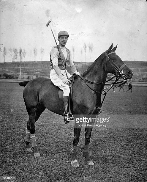 King Alfonso XIII of Spain mounted and ready for polo