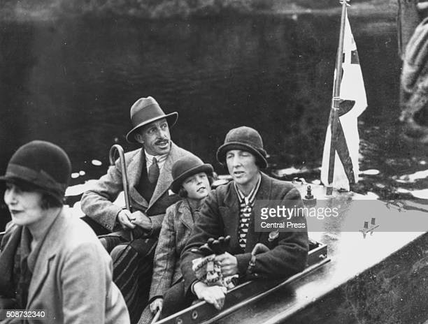 King Alfonso XIII of Spain with the Duchess of Sutherland Lady Londonderry and young Lady Mary Stewart riding on a boat on a loch in Scotland 1934