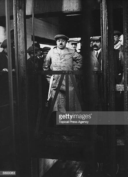 King Amanullah Khan ruler of Afghanistan from 1919 to 1929 at a pit head waiting for the cage to descend on a visit to a pit in Manchester He assumed...