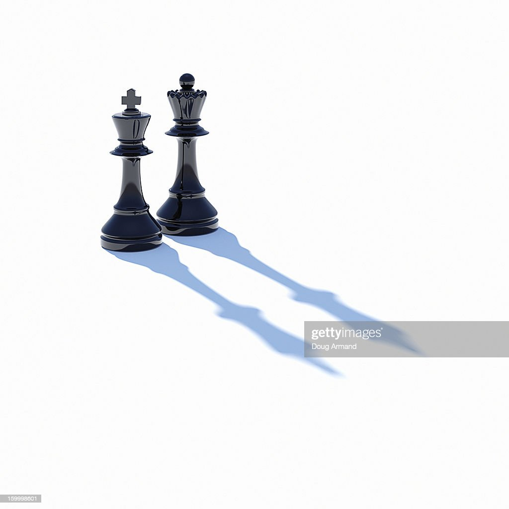 King and Queen chess pieces on white : Stock Photo