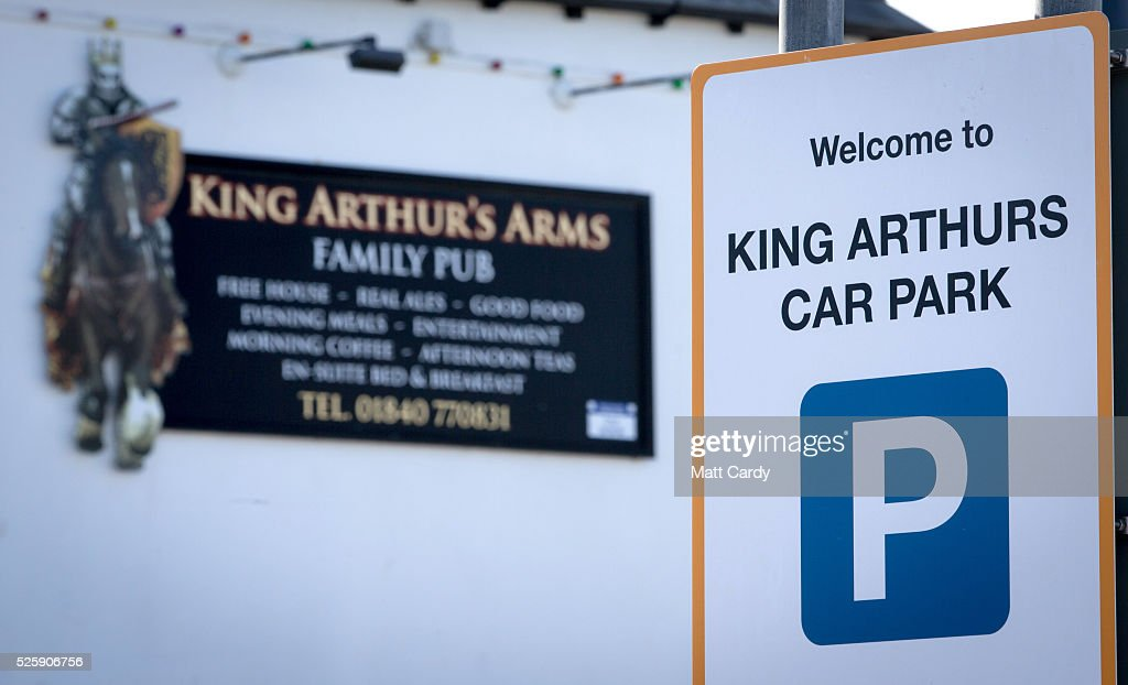 King Arthur inspired signage is displayed in Tintagel on April 28, 2016 in Cornwall, England. The English Heritage managed site and the nearby town have long been associated with the legend of King Arthur and continue to attract large visitor numbers. However, efforts by English Heritage to update the visitor experience with the Gallos sculpture, along with a rock carving of Merlin's face, which English Heritage say are inspired by the legend of King Arthur and Tintagel Castles royal past, have met with criticism from some Cornish nationalists and historians.