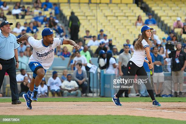 King Bach runs for Amanda Cerny at the Hollywood Stars game at Dodger Stadium on August 27 2016 in Los Angeles California