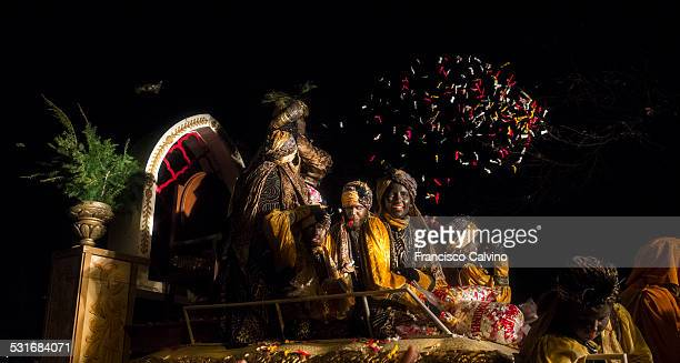King Balthasar giving away sweets at the Three Kings Day parade at Terrassa Barcelona province Spain
