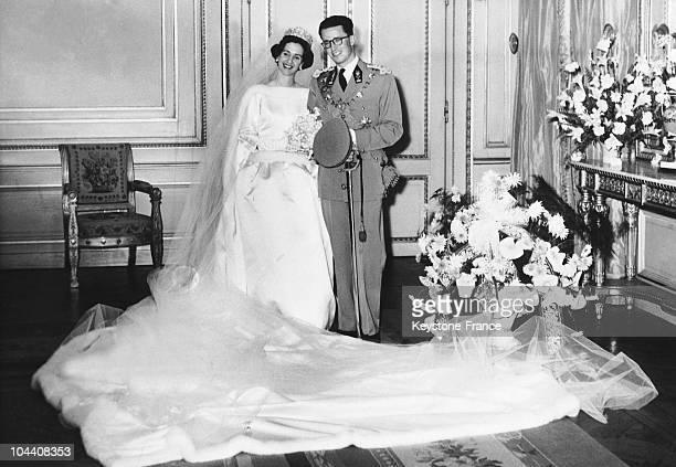 King BAUDOUIN 1st in his lieutenant general army uniform and DONA FABIOLA de MORA y ARAGON wearing a wedding dress made by Cristobal BALENCIAGA...