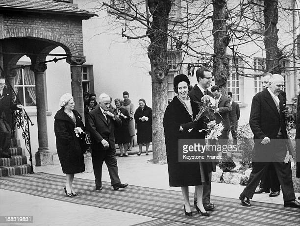 King Baudouin I Of Belgium and wife Queen Fabiola Of Belgium going out the astronomical clock in Lier Belgium during an official visit