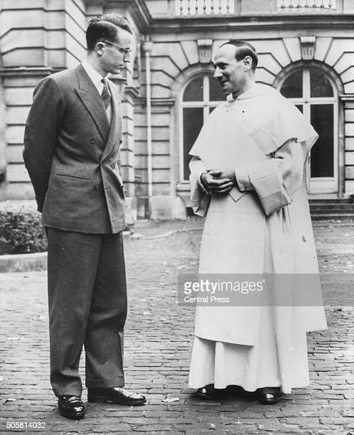King Baudouin of Belgian talking to Dominican friar Dominique Pire winner of the Nobel Peace Prize for helping refugees after World War Two in the...