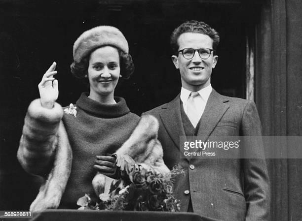 King Baudouin of Belgium and his fiance Dona Fabiola waving from the balcony of the town hall after announcing their engagement Brussels September...