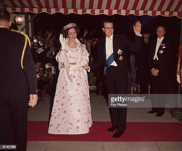 King Baudouin of Belgium and his wife Queen Fabiola arrive at the Belgian Embassy for a banquet during a state visit