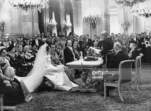 King Baudouin of Belgium and Queen Fabiola of Belgium at their civil wedding ceremony inside the Royal Palace of Brussels, 15th December 1960....
