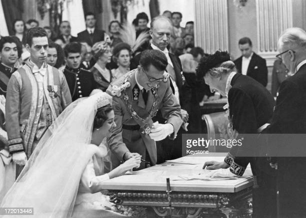 King Baudouin of Belgium and Queen Fabiola of Belgium sign the register after the civil ceremony of their marriage Brussels 15th December 1960