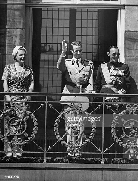 King Baudouin of Belgium on a State Visit to Holland, stands with Queen Juliana of the Netherlands and Prince Bernhard of the Netherlands to...