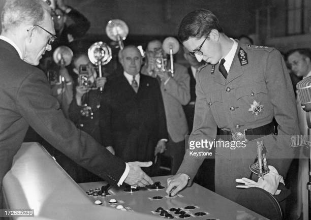 King Baudouin of Belgium performs the ceremony of inaugurating the new buildings and an INR Station at Overyssche Belgium 18th October 1952
