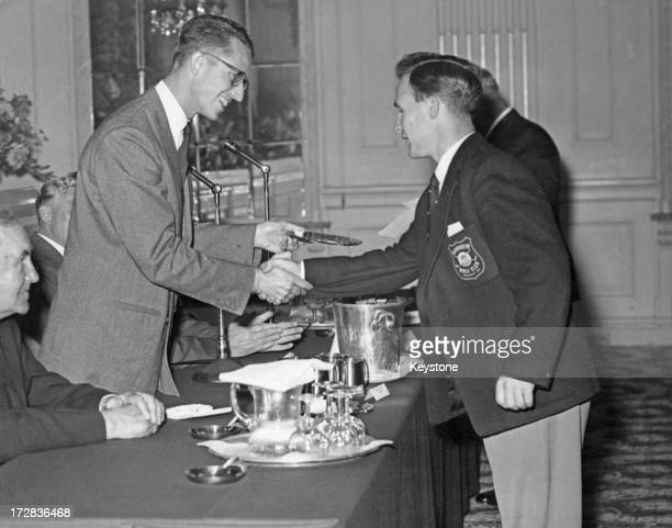 King Baudouin of Belgium presents Sandy Saddler with the award for the best amateur score at the Amateur-Professional Golf Tournament at Gleneagles,...