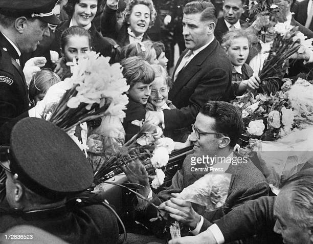 King Baudouin of Belgium returning from his tour of America is greeted by the crowds on his route to the Royal Palace of Laeken Brussels 2nd June 1959