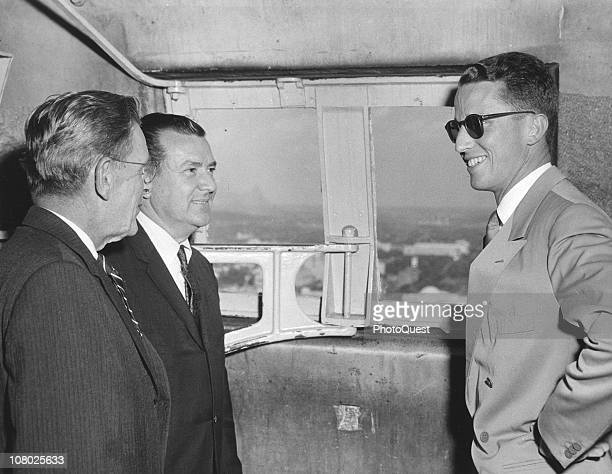 King Baudouin of Belgium smiles at two unidentified men in in the observation chamber of the Washington Monument during a royal state visit to the...