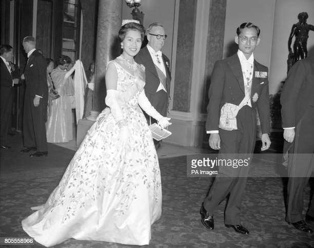King Bhumibol Aduladej and Queen Sirikit of Thailand arriving at Lancaster House, London, for a dinner and reception given in their honour by Selwyn...