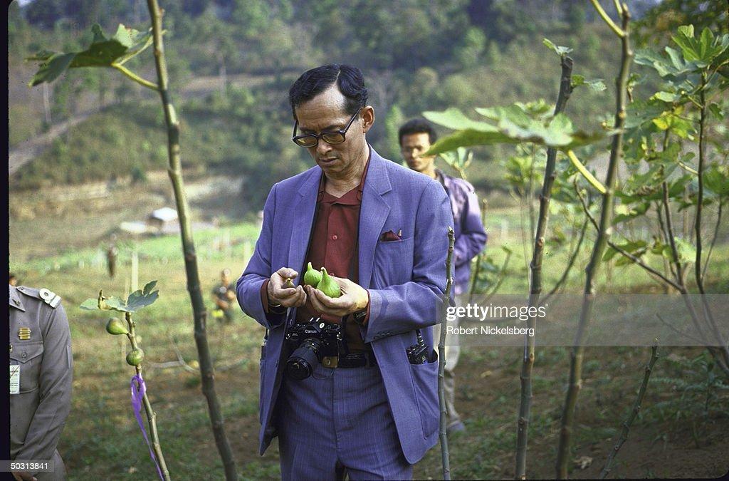 King Bhumibol Adulyadej, aka King Rama, visiting royal sponsored agricultural experiment station at Doi Inthanon Natl. Park.