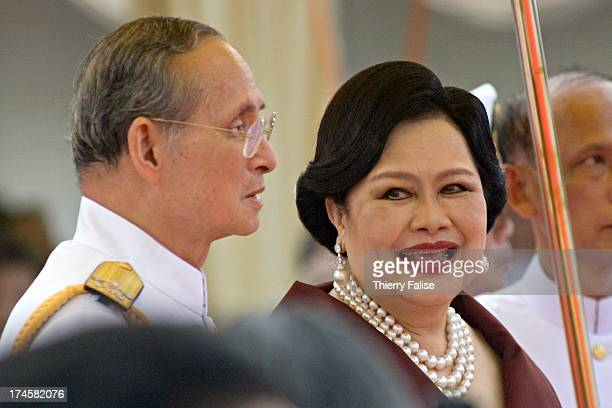 King Bhumibol Adulyadej and Queen Sirikit of Thailand presides over the launching ceremony of Tor 991, a coastal patrol boat at the Royal Naval...