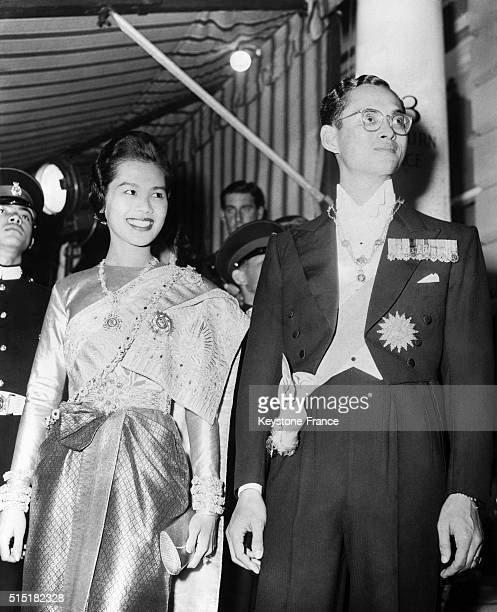 King Bhumibol Adulyadej of Thailand aka Rama IX and wife Queen Sirikit Kitiyakara arrive at the Thai embassy at Ashburn Place in London United...