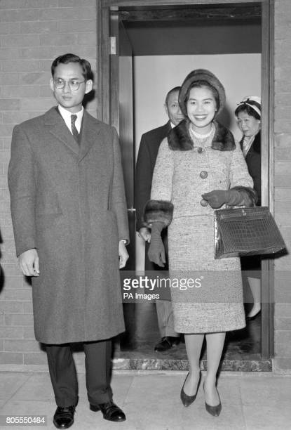 King Bhumibol Adulyadej of Thailand and his consort, Queen Sirikit, arrive at London Airport from Switzerland.